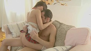 Girl in checked school uniform climbs on a dick