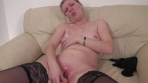 This older slut likes to play on her couch