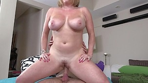Light-haired with big natural jugs is riding on his heavy hard-on
