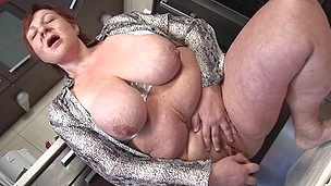 Large breasted older slut playing in her kitchen