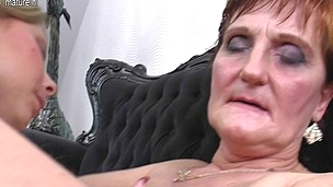 Two nasty old and youthfull lesbian babes do it on the sofa