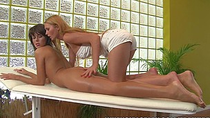 Two beautiful nubiles take turns going down on each other