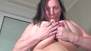Large breasted older slut playing with her toy